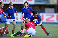 Julie Annery of France is tackled by Bethan Lewis of Wales during the Women's Six Nations Championship Round 3 match between Wales and France at the Cardiff Arms Park in Cardiff, Wales, UK. Sunday 23 February 2020