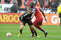 Washington, D.C.- March 29, 2014. Fabian Espindola (9) of D.C. United goes against Bakary Soumare of the Chicago Fire. The Chicago Fire tied D.C. United 2-2 during a Major League Soccer Match for the 2014 season at RFK Stadium.
