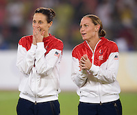 USWNT captain Christie Rampone and teammate Kate Markgraf wait for the medal presentation after playing for the gold medal at Workers' Stadium.  The USWNT defeated Brazil, 1-0, during the 2008 Beijing Olympics women's soccer final in Beijing, China.