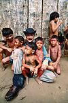 Photographer Art Wolfe with Yanomamo children, Parima Tapirapeco National Park, Venezuela