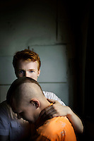 Pavel Lebedev, 23, (orange shirt) with his boyfriend Kirill Kalugin. Pavel says that he has been violently attacked six times in the previous year. In spite of the danger he insists he has the right to be open about his sexuality, and to choose who he loves. On 30 June 2013, Russian President Vladimir Putin signed into law an ambiguous bill banning the 'propaganda of nontraditional sexual relations to minors'. The law met with widespread condemnation from human rights and LGBT groups. (MANDATORY CREDIT   photo: Mads Nissen/Panos Pictures /Felix Features)
