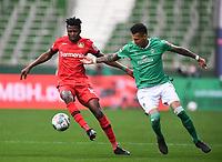 18th May 2020, WESERSTADION, Bremen, Germany; Bundesliga football, Werder Bremen versus Bayer Leverkusen;  Edmond Tapsoba (Leverkusen) turns away from the challenge of Davie Selke (Bremen).