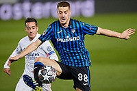 16th March 2021; Madrid, Spain;  Mario Pasalic of Atalanta and Lucas Vazquez of Real Madrid during the Champions League match, round of 16, between Real Madrid and Atalanta played at Alfredo Di Stefano Stadium