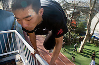 Members of Nanjings TNT parkour team practice on the campus of Nanjing University and in the central Xinjeikou shopping district of Nanjing, Jiangsu, China.