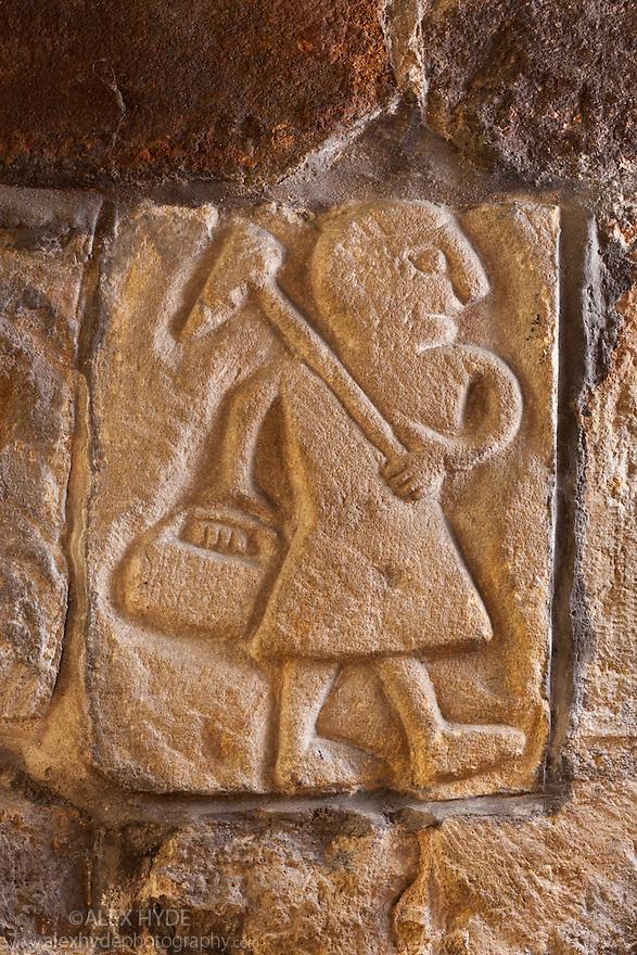 T'owd Man of Bonsall, a piece of Saxon stonework depicting a lead miner. St Mary's Church, Wirksworth Church, Derbyshire, UK.