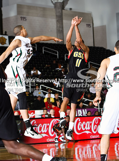 Mississippi Valley State Delta Devils forward Jason Holmes (42) and Grambling State Tigers guard/forward Justin Patton (11) in action during the SWAC Tournament game between the Grambling State Tigers and the Mississippi Valley State Delta Devils at the Special Events Center in Garland, Texas. Grambling State defeats Mississippi Valley 65 to 62