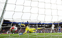 Lukasz Fabianski of Swansea City is beaten by Riyad Mahrez of Leicester City to score the first goal during the Barclays Premier League match between Leicester City and Swansea City played at The King Power Stadium, Leicester on April 24th 2016
