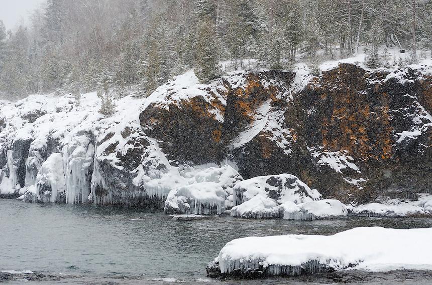 A wintery scene along the rocky Lake Superior shoreline. Marquette, MI