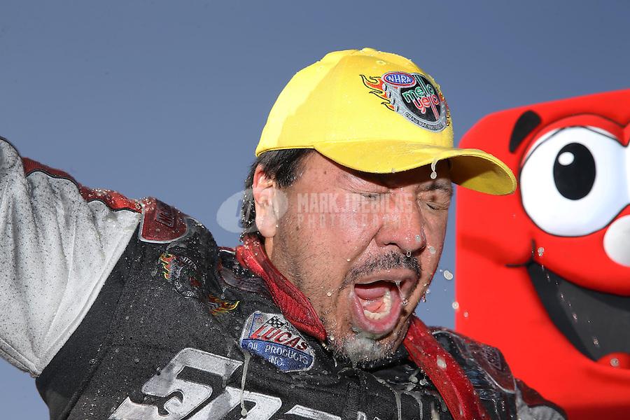 Apr. 7, 2013; Las Vegas, NV, USA: NHRA funny car driver Cruz Pedregon celebrates after winning the Summitracing.com Nationals at the Strip at Las Vegas Motor Speedway. Mandatory Credit: Mark J. Rebilas-