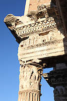 Rome, Fora: A lateral view of the high part of one of the so-called Colonnacce, the ancient Roman columns that decorated the surrounding wall of the Forum of the emperor Nerva  (I century AD). It was a sunny day and in particular the bas relief that lies on the column top is enlightened.