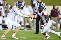 Ole Miss quarterback Bo Wallace (14) handoff to running back Jaylen Walton (6) during second half of an NCAA football game, Saturday, October 11, 2014 in College Station, Tex. Ole Miss defeated Texas A&M 35-20. (Mo Khursheed/TFV Media via AP Images)