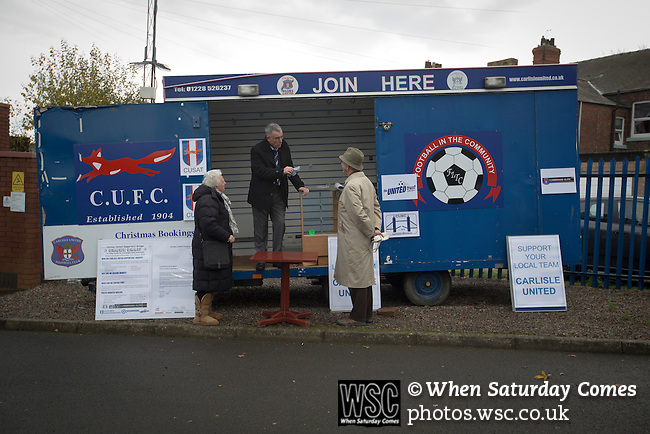 Carlisle United 1 Accrington Stanley 0, 15/11/2014. Brunton Park, League Two. Members of the home team's supporters' trust touting for business from their caravan outside the ground prior to the English League Two match between Carlisle United and visitors Accrington Stanley at Brunton Park. The match was won by the home team by one goal to nil, the winner scored by Derek Asamoah in the 21st minute. The match was watched by 4,069 spectators. Photo by Colin McPherson.