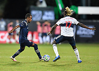 LAKE BUENA VISTA, FL - JULY 26: Gadi Kinda of Sporting KC is defended by Leonard Owusu of Vancouver Whitecaps FC during a game between Vancouver Whitecaps and Sporting Kansas City at ESPN Wide World of Sports on July 26, 2020 in Lake Buena Vista, Florida.