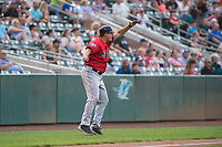 Billings Mustangs third base coach Bryan LaHair (29) waves home a runner during a Pioneer League game against the Ogden Raptors at Lindquist Field on August 17, 2018 in Ogden, Utah. The Billings Mustangs defeated the Ogden Raptors by a score of 6-3. (Zachary Lucy/Four Seam Images)