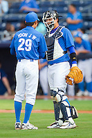 Catcher Youn-Joon Cho #12 has a chat with Ji-Woong Yoon #29 during an exhibition game against Team USA at Durham Bulls Athletic Park July 18, 2010, in Durham, North Carolina.  Photo by Brian Westerholt / Four Seam Images