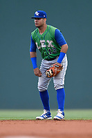 Second baseman Gabriel Cancel (12) of the Lexington Legends plays defense in a game against the Greenville Drive on Friday, June 30, 2017, at Fluor Field at the West End in Greenville, South Carolina. Lexington won, 17-7. (Tom Priddy/Four Seam Images)
