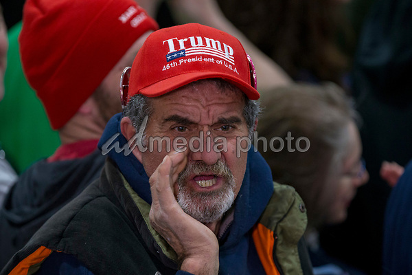 """A supporter yells, """"fake news"""" at the media during a Make America Great Again campaign rally at Atlantic Aviation in Moon Township, Pennsylvania on March 10th, 2018. Photo Credit: Alex Edelman/CNP/AdMedia"""