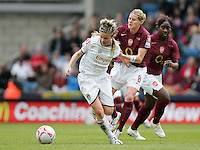Arsenal vs Leeds United - Womens FA Cup Final at Millwall Football Club - 01/05/06 - Arsenal's Kelly Smith gets to grips with Sue Smith (left) - (Gavin Ellis 2006)