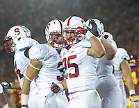 LOS ANGELES, CA - November 16, 2013:  Stanford Cardinal running back Tyler Gaffney (25) celebrates his first touchdown of the game during the Stanford Cardinal vs the USC Trojans at Los Angeles Memorial Coliseum in Los Angeles, CA. Final score Stanford Cardinal 17, USC Trojans  20.