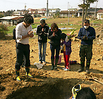 """Ms. Mayumi Miura, 56, center, and her friends and relatives pray before pull out her father's body from a temporary grave yard in Ishinomaki, Miyagi. One month after the earthquake, they finally managed to arrange a family funeral. """"We are so relieved that we are finally able to put him into his grave,"""" Ms. Mimura said. His father was washed away by tsunami in front of his wife, Mrs. Katsumi Saito, 69. <br /> """"He was hanging on to a telephone pole, but after all he was taken away by the tsunami,"""" said his wife, Mrs. Saito. """"He waved his hands to me in the water to say goodbye. I could not help him.""""<br /> <br /> On March 11, 2011, the earthquake of magnitude 9.0, the biggest earthquake in the history of Japan and the fourth biggest earthquake in the world after year 1900, shocked the Tohoku area of Japan. In about 30 minutes, devastating tsunami reached, affecting the coastline with a length of 500 km (310 miles). The tsunami wave height of 39 meters (128 feet) was recorded in a port town in Tohoku. The tsunami swallowed villages along the coast and washed away all houses. The earthquake and tsunami killed more than 15,800 people, and still more than 3,500 people are missing."""