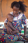 In the town of Djibo in northern Burkina Faso, a Fulani child is sick with malaria.  While easily prevented by sleeping under an insecticide-treated mosquito net every night, throughout Africa, malaria is a major killer of pregnant women and children under five.
