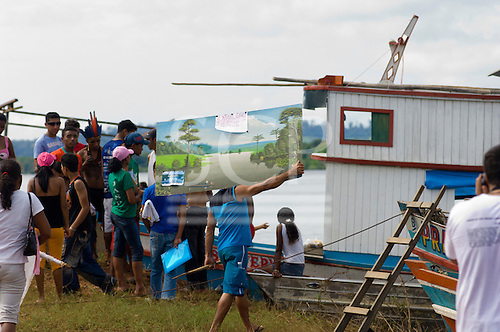 """Altamira, Brazil. """"Xingu Vivo Para Sempre"""" protest meeting about the proposed Belo Monte hydroeletric dam and other dams on the Xingu river and its tributaries. Carrying a painting of the Xingu."""