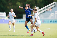CARY, NC - SEPTEMBER 12: Debinha #10 of the NC Courage defends against Christen Westphal #18 of the Portland Thorns during a game between Portland Thorns FC and North Carolina Courage at WakeMed Soccer Park on September 12, 2021 in Cary, North Carolina.