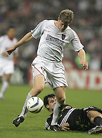 30 October,  2004.  John Wolyniec (15) of the MetroStars keeps control of the ball during the 2004 MLS playoffs at RFK Stadium in Washington, DC.