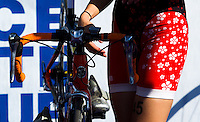 16 SEP 2012 - NICE, FRA - Elodie Barret of Brive Limousin Triathlon prepares her bike in transition before the start of the women's French Grand Prix triathlon series final stage held during the Triathlon de Nice Côte d'Azur (PHOTO (C) 2012 NIGEL FARROW)