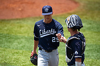 Liberty Flames starting pitcher Trevor Delaite (29) makes his way to the dugout during the game against the Duke Blue Devils in NCAA Regional play on Robert M. Lindsay Field at Lindsey Nelson Stadium on June 4, 2021, in Knoxville, Tennessee. (Danny Parker/Four Seam Images)