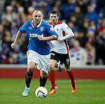 Kris Boyd running up the park after a shirt change in the second half