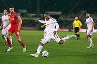 SWANSEA, WALES - MARCH 16: Ashley Williams of Swansea kicks the ball away from the Swansea box during the Premier League match between Swansea City and Liverpool at the Liberty Stadium on March 16, 2015 in Swansea, Wales