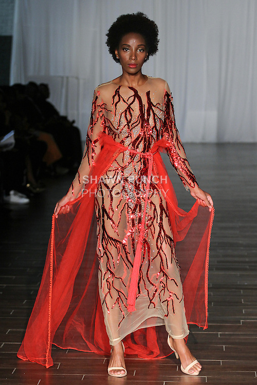 Model walks runway in outfits from the Kacem Sahl Haute couture collection for Fashion Week Brooklyn Spring Summer 2017, on October 8th 2016 at Brooklyn Expo Center.
