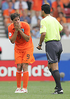 Dutch forward (9) Ruud Van Nistelrooij can't believe the call of referee Oscar Ruiz in the first half of play. Netherlands defeated Côte d'Ivoire 2-1 in their FIFA World Cup Group C match at Gottlieb-Daimler-Stadion, Stuttgart, Germany, June 16, 2006.