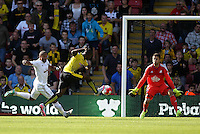 Odion Ighalo of Watford scores the opening goal past Lukasz Fabianski of Swansea   during the Barclays Premier League match Watford and Swansea   played at Vicarage Road Stadium , Watford