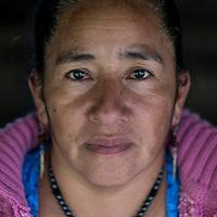 20 noviembre 2014. <br /> Aurora Velazquez (42 años). Hermana de Rogelio uno de los presos políticos de la protesta. Activista en contra de la hidroeléctrica Ecoener, en Santa Cruz de Barillas, Guatemala.<br /> La llegada de algunas compañías extranjeras a América Latina ha provocado abusos a los derechos de las poblaciones indígenas y represión a su defensa del medio ambiente. En Santa Cruz de Barillas, Guatemala, el proyecto de la hidroeléctrica española Ecoener ha desatado crímenes, violentos disturbios, la declaración del estado de sitio por parte del ejército y la encarcelación de una decena de activistas contrarios a los planes de la empresa. Un grupo de indígenas mayas, en su mayoría mujeres, mantiene cortado un camino y ha instalado un campamento de resistencia para que las máquinas de la empresa no puedan entrar a trabajar. La persecución ha provocado además que algunos ecologistas, con órdenes de busca y captura, hayan tenido que esconderse durante meses en la selva guatemalteca.<br /> <br /> En Cobán, también en Guatemala, la hidroeléctrica Renace se ha instalado con amenazas a la población y falsas promesas de desarrollo para la zona. Como en Santa Cruz de Barillas, el proyecto ha dividido y provocado enfrentamientos entre la población. La empresa ha cortado el acceso al río para miles de personas y no ha respetado la estrecha relación de los indígenas mayas con la naturaleza. ©Calamar2/ Pedro ARMESTRE<br /> <br /> The arrival of some foreign companies to Latin America has provoked abuses of the rights of indigenous peoples and repression of their defense of the environment. In Santa Cruz de Barillas, Guatemala, the project of the Spanish hydroelectric Ecoener has caused murders, violent riots, the declaration of a state of siege by the army and the imprisonment of a dozen activists opposed to the project . <br /> A group of Mayan Indians, mostly women, has cut a path and has installed a resistance camp to prevent the enter of the company's machines. The