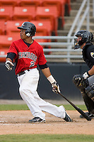 Leonel De Los Santos #2 of the Hickory Crawdads follows through on his swing versus the West Virginia Power at L.P. Frans Stadium June 21, 2009 in Hickory, North Carolina. (Photo by Brian Westerholt / Four Seam Images)