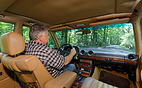Martin Buckley drives the 1979 Mercedes W123 300 Turbo Diesel from Missouri in the USA, at Gliffaes Hotel near Abergavenny, Wales, UK. Friday 24 August 2019