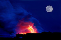 Explosions and steam clouds under a full moon, where lava fromthe Big Island's Kilauea volcanoreaches the Pacific Ocean.