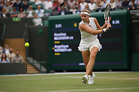 6th July 2021, Wimbledon, SW London, England; 2021 Wimbledon Championships, day 8;  Karolina Muchova of the Czech Republic hits a return during the womens quarterfinal match