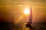Sailing into the sunset along the Forgotten Coast of the north Florida Panhandle at Shell Point in Wakulla County, Florida .