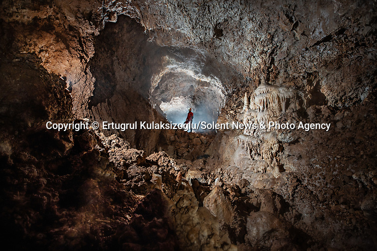Pictured:   Haşhaş Cave, Bartın, Turkey.<br /> <br /> A team of explorers venture through a series of incredible caves filled with huge stalagmites and underwater lakes.<br /> <br /> The adventurers are carrying out tests in the subterranean world to work out how old the caves are and how they were formed.<br /> <br /> The intriguing images were captured in caves across Turkey by amateur photographer Ertuğrul Kulaksizoglu.   SEE OUR COPY FOR FULL DETAILS.<br /> <br /> <br /> Please byline: Ertugrul Kulaksizoglu/Solent News<br /> <br /> © Ertugrul Kulaksizoglu/Solent News & Photo Agency<br /> UK +44 (0) 2380 458800