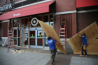 NEW YORK, NEW YORK - MAY 31: workers place wood plates out side a mall in Brooklyn on May 31, 2020 in New York. Protests spread across the country in at least 30 cities in the United States. USA For the death of unarmed black man George Floyd at the hands of a police officer, this is the latest death in a series of police deaths of black Americans (Photo by Pablo Monsalve / VIEWpress via Getty Images)