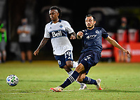 LAKE BUENA VISTA, FL - JULY 26: Roberto Puncec of Sporting KC passes away from Yordy Reyna of Vancouver Whitecaps FC during a game between Vancouver Whitecaps and Sporting Kansas City at ESPN Wide World of Sports on July 26, 2020 in Lake Buena Vista, Florida.