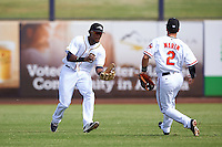 Peoria Javelinas Franchy Cordero (10), of the San Diego Padres organization, fields a ball in front of Adrian Marin (2) during a game against the Surprise Saguaros on October 12, 2016 at Peoria Stadium in Peoria, Arizona.  The game ended in a 7-7 tie after eleven innings.  (Mike Janes/Four Seam Images)