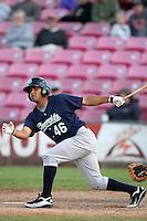 Eugene Emeralds infielder Jorge Minyety #46 bats against the Salem-Keizer Volcanoes at Volcanoes Stadium on August 9, 2011 in Salem-Keizer,Oregon. Eugene defeated Salem-Keizer 13-7.(Larry Goren/Four Seam Images)