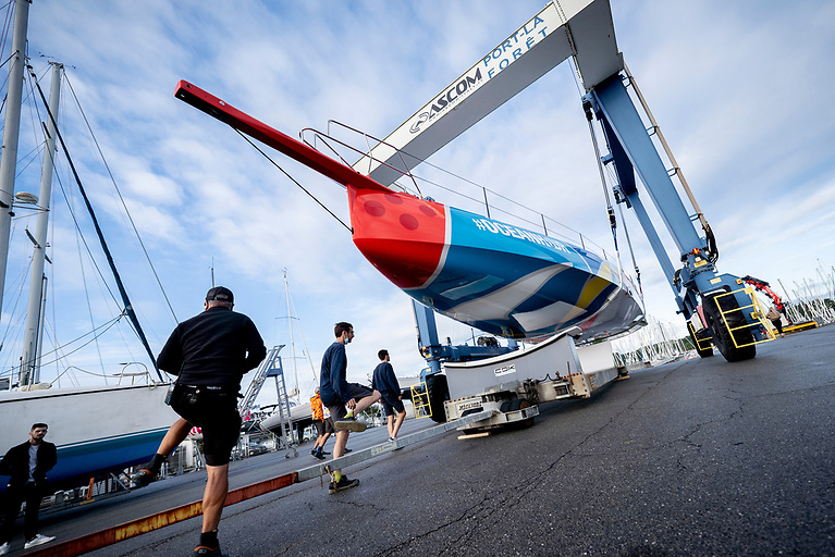 11th Hour Racing's new IMOCA is rolled out of the shed at CDK Technologies in Port La Foret to see sunlight for the first time.