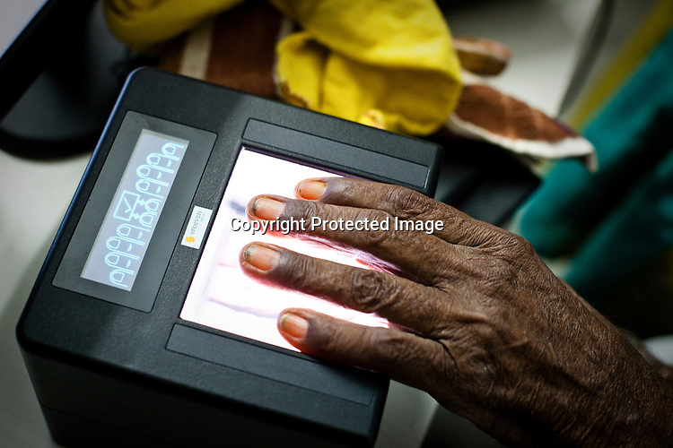 95 year old Gandaiah places his fingers for fingerprint scan during the enrollment process in Naagaaram village, outskirts of Hyderabad in Andhra Pradesh, India. India is assigning each one of its 1.2 billion people a unique ID number based on digital finger prints and iris scan. Photograph: Sanjit Das/Panos