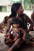 Pikany Village, Brazil. Kayapo mother and child, both painted with black and red body paint designs; Xingu reserve.