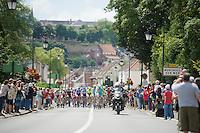 peloton moving through the village of Montreuil Sur Mer with Team Astana leading<br /> <br /> 2014 Tour de France<br /> stage 4: Le Touquet-Paris-Plage/Lille Métropole (163km)
